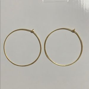 Johnny was gold hoops earrings